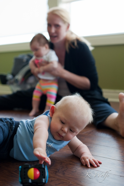 Mom & baby yoga at Whole Family Health. Really just mom yoga while baby rolls around on the floor.