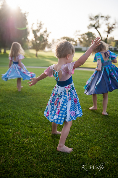 The girls demonstrating how to use their new Twirly Girl dresses