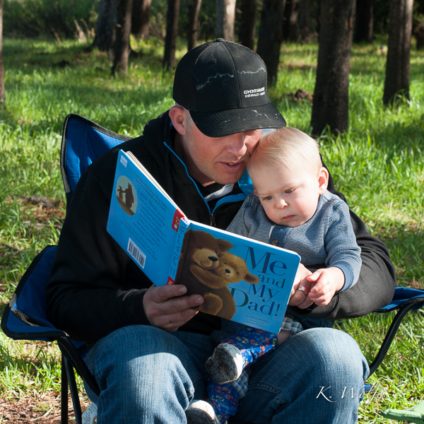 Daddy reading Kane his new Father's Day book