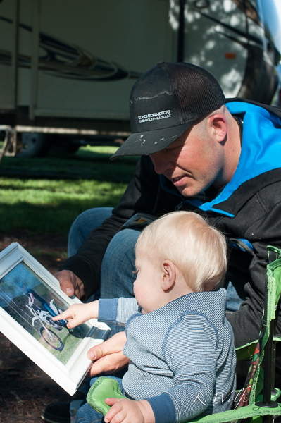 Showing Daddy the photo we gave him