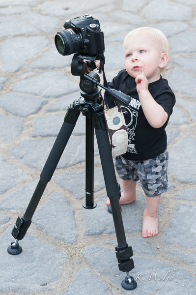 Oh snap...my little photographer checking out the set-up