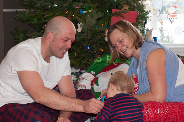 Opening stockings: Daddy got a kids bathtub shaving kit and was showing Kane how to use it.