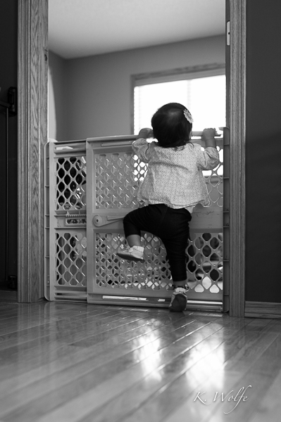 Trying to get into her playroom.