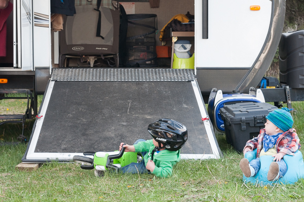 Maverick watching Kane riding down the trailer ramp on his bike.