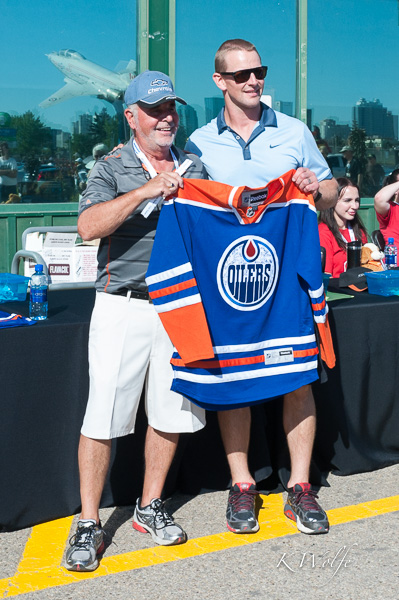 This gentleman won an autographed Oilers jersey, which was presented to him by Matt Hendriks.